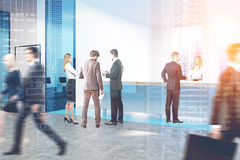 People in blue glass office double Stock Photography