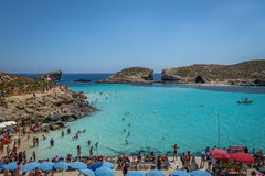 People at the Blue Lagoon in Comino Island - Gozo, Malta. GOZO, MALTA - Jun 21, 2015: People at the Blue Lagoon in Comino Island - Gozo, Malta Stock Images