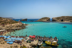 People at the Blue Lagoon in Comino Island - Gozo, Malta. GOZO, MALTA - Jun 21, 2015: People at the Blue Lagoon in Comino Island - Gozo, Malta Royalty Free Stock Photos