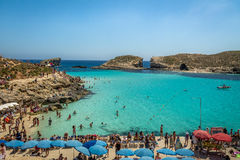People at the Blue Lagoon in Comino Island - Gozo, Malta. GOZO, MALTA - Jun 21, 2015: People at the Blue Lagoon in Comino Island - Gozo, Malta Stock Image