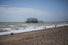 People, blue skies and the old pier. Royalty Free Stock Photos