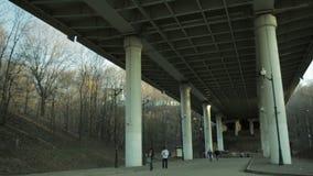 People in blur walking under the bridge. Royalty Free Stock Photos