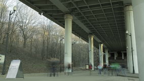 People in blur walking under the bridge Stock Photos