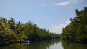 People blurred far away on boat travel Kalu Ganga river in Sri Lanka. People blurred travelling by boat in summer day in Sri lanka stock video