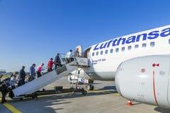 People board a Lufthansa aircraft Royalty Free Stock Photos