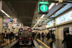 People board train at Osaka Hankyu Umeda Station Royalty Free Stock Photography