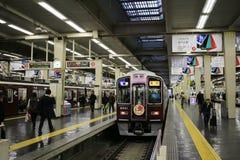 People board train at Osaka Hankyu Umeda Station Royalty Free Stock Photos