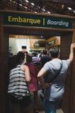 People on the boarding lane to the Cataratas. Foz do Iguacu, Brazil - January 07, 2018: People on the boarding lane to take a ride by eco bus to the Cataratas do Royalty Free Stock Photos