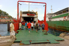 People boarding a ship at the grenadines wharf Royalty Free Stock Images