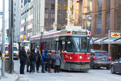 People Boarding a Streetcar in Toronto Royalty Free Stock Image