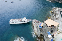 People boarding the turistic boat at the harbor of Vernazza Royalty Free Stock Image