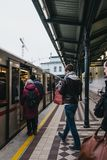 People boarding the underground train at Schonbrunn station in Vienna. Austria. Vienna, Austria - November 25, 2018: People boarding the underground train at royalty free stock image