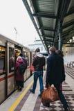 People boarding the underground train at Schonbrunn station in Vienna. Austria. Vienna, Austria - November 25, 2018: People boarding the underground train at royalty free stock photos