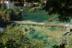 People at a boardwalk and swimming at the Krka National Park Stock Photo