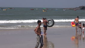 People and boat on Arabian sea beautiful resort beach in Goa stock video footage