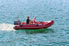 People in the Boat in Ascona on Lake Maggiore. Ascona, Switzerland - August 23, 2016: People in the Boat in Ascona on Lake Maggiore in Ticino canton in Stock Photo