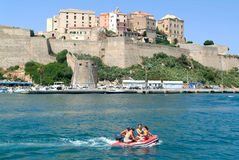 People on a boat in front of Calvi Royalty Free Stock Image