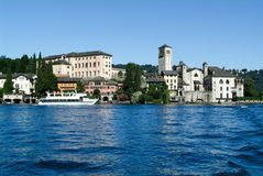 People on a boat in front of San Giulio island Royalty Free Stock Photos