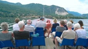 People on a boat, Italy. 20.06.2016 - Stresa, Italy. People on a boat Italy Tourists lake Maggiore scenery stock video