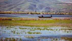 People in the boat. Lashihai lake, Yunnan Province, China Royalty Free Stock Photos