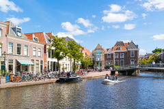 People in boat on Rhine canal in Leiden, Netherlands Royalty Free Stock Photos