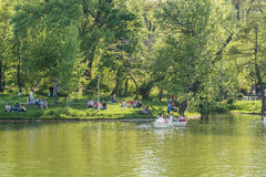 People Boat Ride On Carol Public Park Lake On Spring Day stock photo