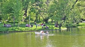 People Boat Ride On Carol Public Park Lake On Spring Day stock footage