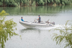 People in a boat on the Riet River Stock Photography