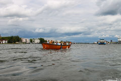 People in the boat on tours of the canals of Amsterdam Stock Image
