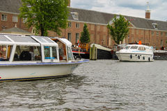 People in the boat on tours of the canals of Amsterdam Royalty Free Stock Photography