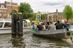 People in the boat on tours of the canals of Amsterdam Stock Photos