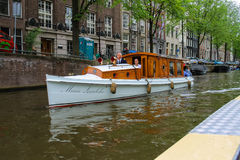 People in the boat on tours of the canals of Amsterdam Royalty Free Stock Photos