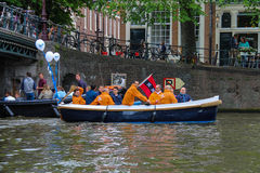 People in the boat on tours of the canals of Amsterdam Royalty Free Stock Images