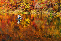 People boating on the autumn lake Royalty Free Stock Photography