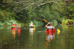 People boating on river. Peacefull nature scene Royalty Free Stock Photos