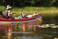 People boating on river. People boating on small river and having fun Royalty Free Stock Photos