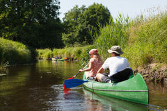 People boating on river. People boating on small river and having fun Royalty Free Stock Photo