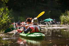 People boating on river. People boating on small river and having fun Stock Image