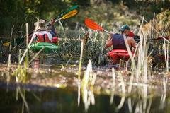 People boating on river stock photography