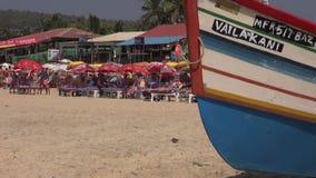 People and boats on Arabian sea beautiful resort beach in Goa, Panaji. GOA, INDIA, JANUARY 12, 2014: people and boats on Arabian sea beautiful resort beach in stock video footage