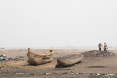 People and boats on a beach in Jamestown, Accra, Ghana Stock Images