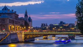 People and boats day to night timelapse, Le Pont D`Arcole bridge after sunset, Paris, France, Europe. People and boats day to night transition timelapse, Le Pont stock footage