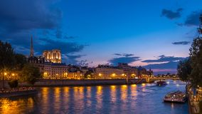 People and boats day to night timelapse, Le Pont D`Arcole bridge after sunset, Paris, France, Europe. People and boats day to night transition timelapse with stock footage