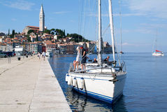 People on boats in front of Rovinj on Croatia Stock Image