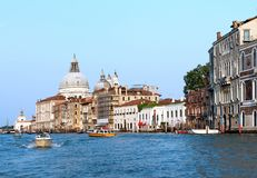 people on boats in venice. sea in italy. view of the cathedral and the house. home on stilts. bo