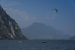 People in boats and on the water practicing sailing and sailing sports. Lake Garda Stock Photos
