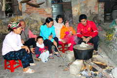 People boiling rice cake Stock Image
