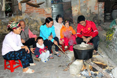 People boiling rice cake Stock Images