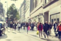 People in bokeh, street of London Stock Image
