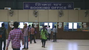 People at the booking office of train station in Mumbai. stock video footage